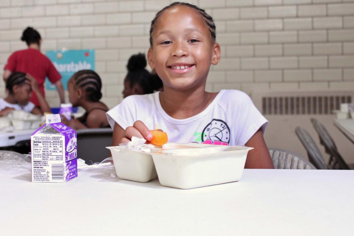 Smiling Girl Eating Lunch